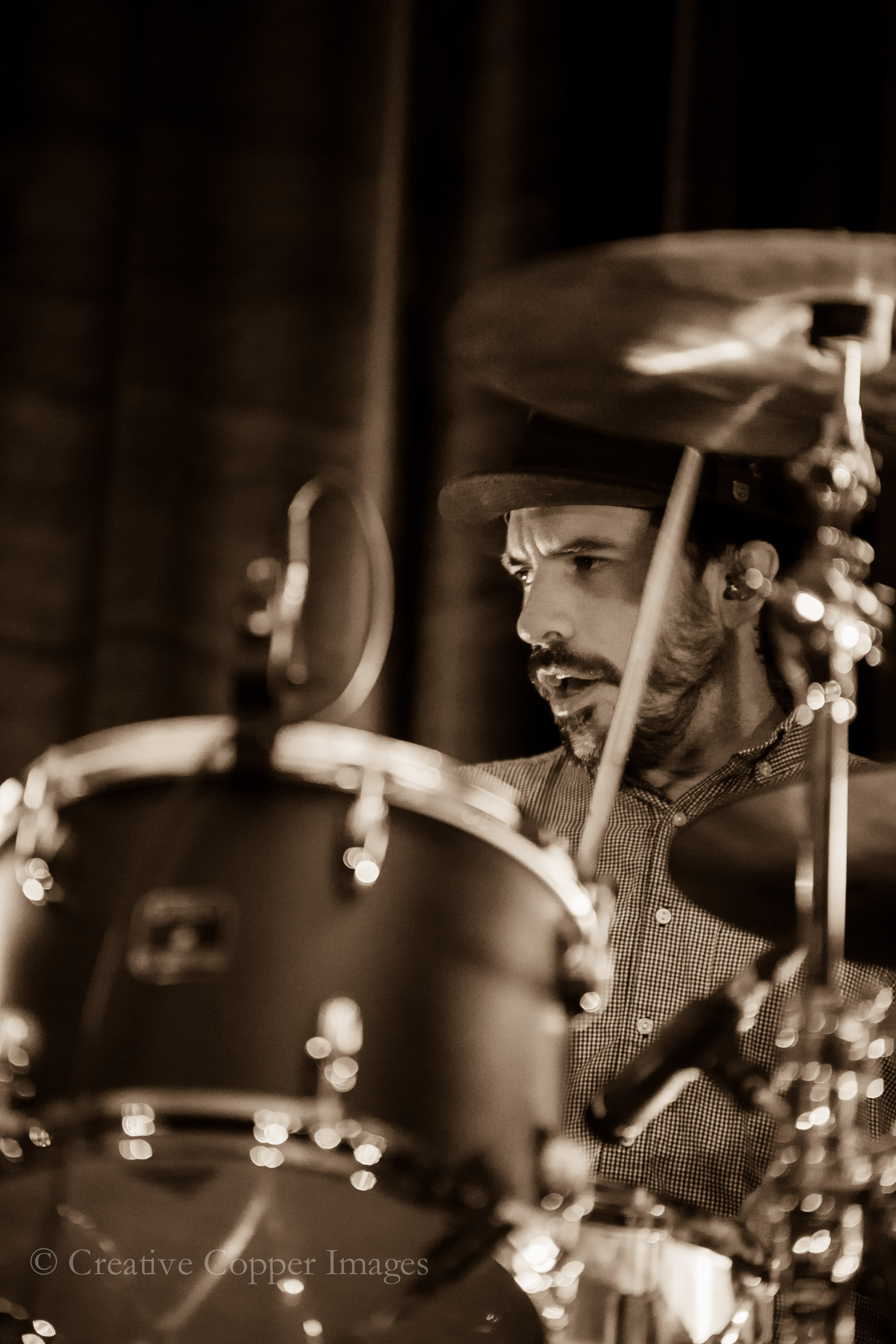 Daren Taylor of The Airborne Toxic Event hides out behind his old fashioned drum kit in Vancouver. Photo by Creative Copper Images.